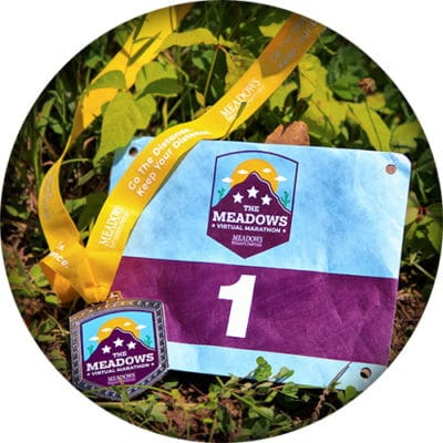 Race medal and bib for Meadows Virtual Marathon